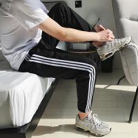 潮流运动裤男士宽松收口卫裤�氤毙菹行〗趴憬治栉�哈裤子