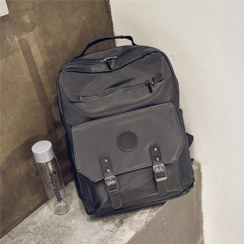 韩版双肩包男女英伦时尚新款个性潮流大学生书包男士背包旅行潮包zl 黑色