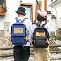 帆布韩版双肩包男电脑包背包学院风大学生书包女休闲大容量旅行包