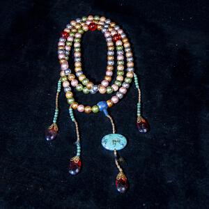 Z1321清《朝珠一套》(此套朝珠用材讲究,精选天然五彩珍珠108颗,配青金石及水晶串连而成。包浆丰润,保存完整。)